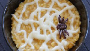Pumpkin risotto with parmesan cheese cream - Halloween