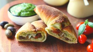 Calzone pizza with basil pesto, cherry tomatoes and provolone cheese recipe