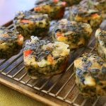 Breakfast egg muffins with Swiss chard, tomato and cheese
