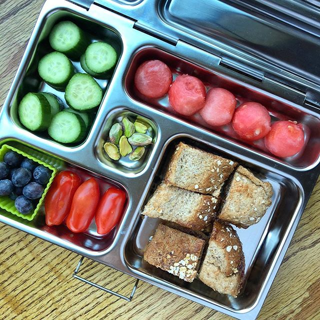 Special request today from my older one: almond butter and jam sandwich…it's Friday and why not?  So…almond butter and grapes jelly (homemade) sandwich bites + watermelon balls (the first of the season!!) + tomatoes + cucumber + pistachios + blueberries. Happy Free Friday