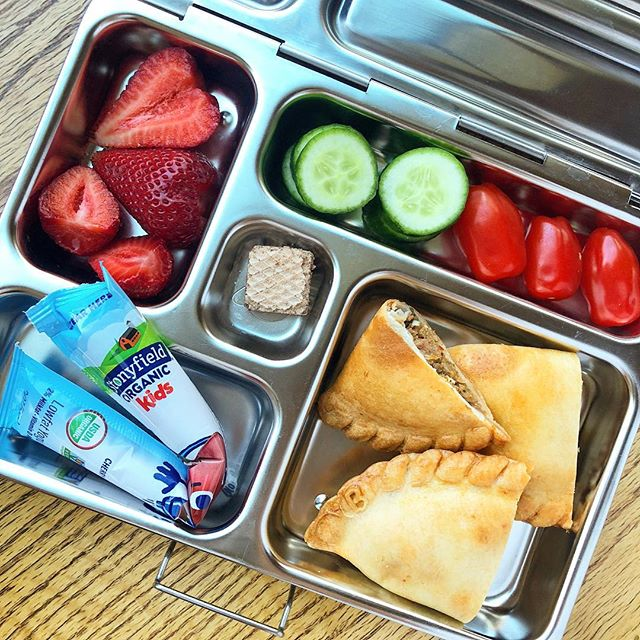Beef empanadas (from the Argentinian market) + strawberries + tomato + cucumber + chocolate wafer + low sugar kids yogurt @stonyfield Happy Monday